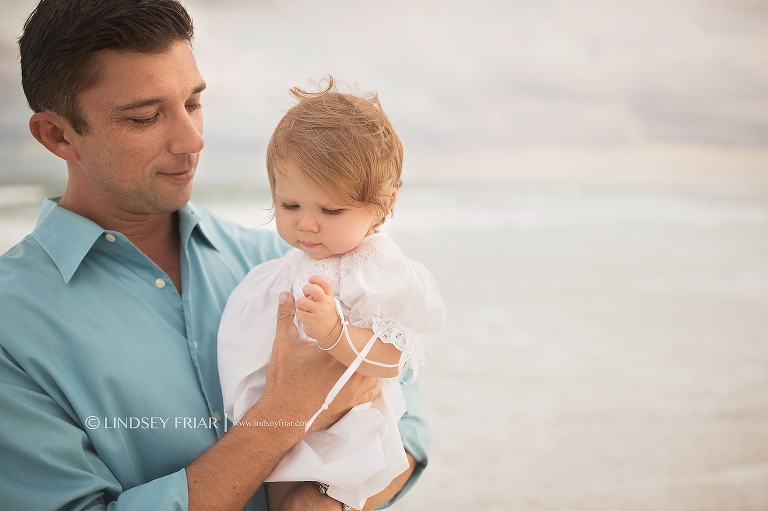 Daddy holding his little girl on Pensacola Beach
